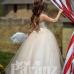 Ivory-white soft and long tulle skirt dress with glitz flower appliquéd bodice side view