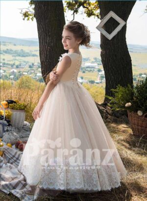 Long light pink tulle skirt dress with pearl studded appliqué bodice side view
