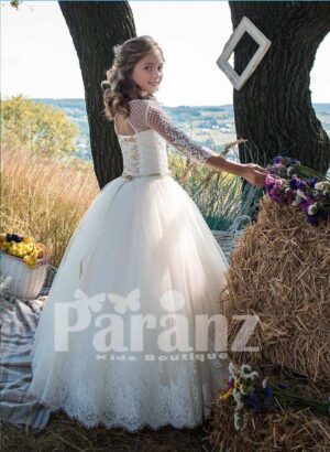 Satin and net knitted white flower appliquéd bodice and long tulle skirt dress side view