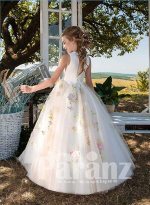 Satin-sheer ball gown dress with long tulle skirt and colorful floral appliqués side view