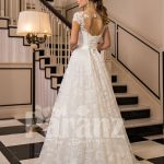 All-over lace work beautiful floor length white tulle wedding gown with royal bodice back side view