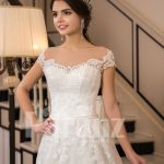 All-over lace work beautiful floor length white tulle wedding gown with royal bodice close view