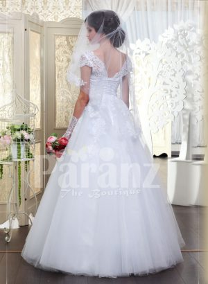 Beautiful milk white flared tulle skirt wedding gown with royal thread appliquéd bodice back side view