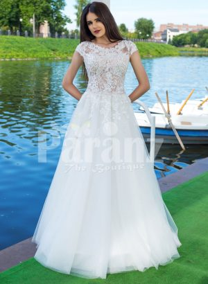Elegant pearl white floor length flared tulle skirt wedding gown with lacy bodice