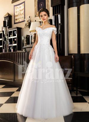Floor length pearl white off-shoulder satin gown with high volume tulle skirt