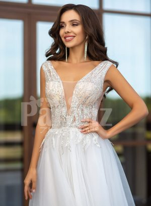 Floor length pearl white tulle wedding gown with glam sheer bodice close view