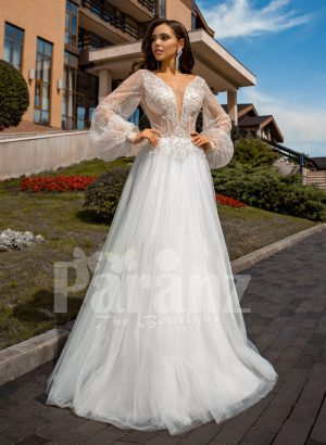 Floor length white tulle skirt gown with Arabic princess sleeves and bodice