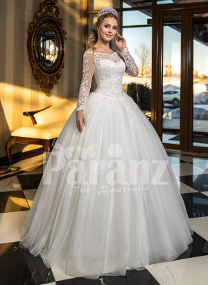 High volume tulle skirt wedding gown with full sleeve royal bodice in white