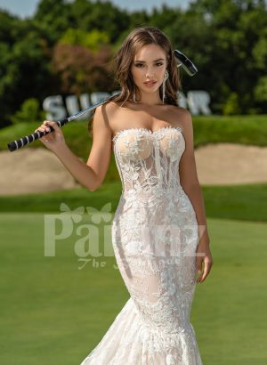 Mermaid style flared trail tulle wedding gown with rich lace work