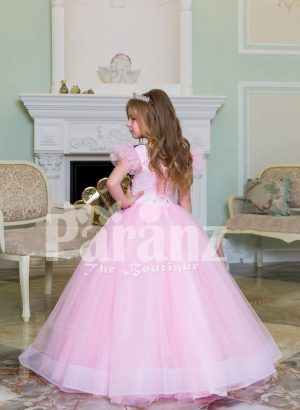 Beautiful floor length light pink baby gown with floral appliquéd bodice and tulle skirt back side view