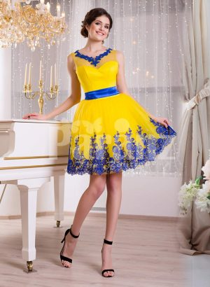 Bright yellow small evening gown with short tulle skirt and rich blue lace work