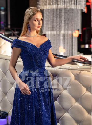 Elegant blue glitz evening gown with off-shoulder bodice and side slit skirt