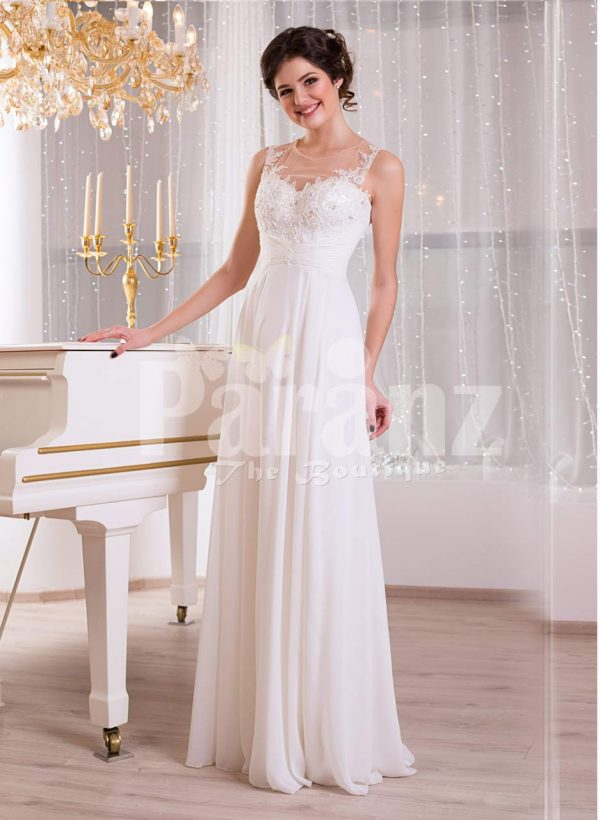 Elegant pearl white sleeveless evening gown with long tulle skirt and lace appliquéd bodice