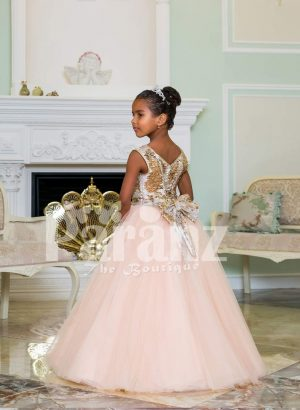 Exciting golden glitz bodice sleeveless baby gown with flared & high volume pink tulle skirt side view