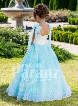 Floor length elegant baby gown with rich white satin bodice and shoulder sheer frills back side view
