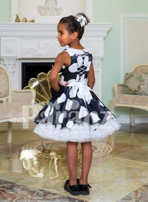 Navy blue tea length tulle skirt sleeveless party dress with white ball print all over back side view