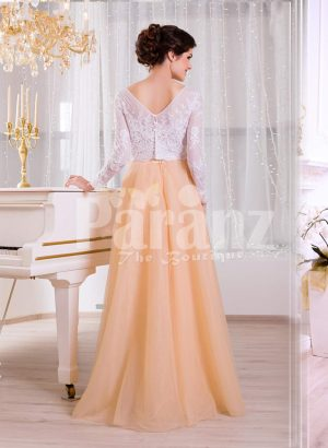 Paranz's floor length elegant evening gown with royal white bodice and peachy orange tulle skirt back side view
