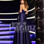 Women's navy floor length rich satin evening gown with stylish off-shoulder bodice back side view