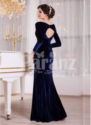Women's navy velvet floor length evening gown with elegant white lace works back side view