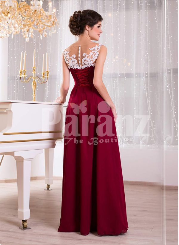 Women's white lace appliquéd bodice glam evening gown with long maroon skirt back side view
