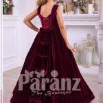 Pigmented burgundy floor length velvet dress with big flower prints back side view