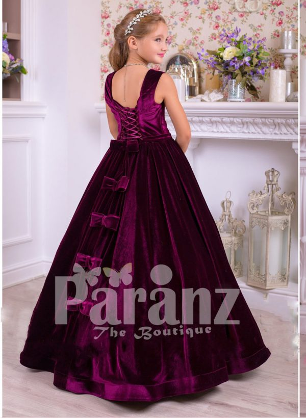 Rich satin floor length baby party gown with tulle skirt underneath and rhinestone waist belt side view