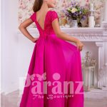 Soft and lightweight rich satin skirt and delicate lacework bodice party gown in fuchsia pink back side view