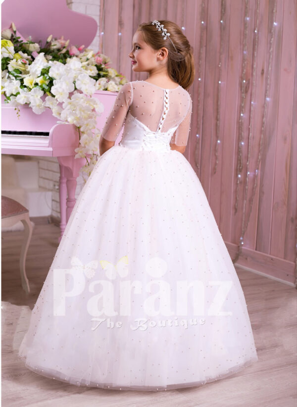 Beautiful pearl white floor length high volume tulle skirt dress with rhinestone waist belt back side view
