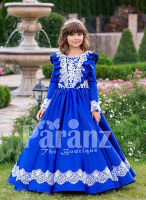 Bright royal blue full sleeve floor length rich satin dress with detail white lace work