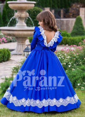 Bright royal blue full sleeve floor length rich satin dress with detail white lace work back side view