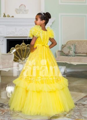 Bright yellow floor length ruffle-tulle elegant party gown for girls back side view