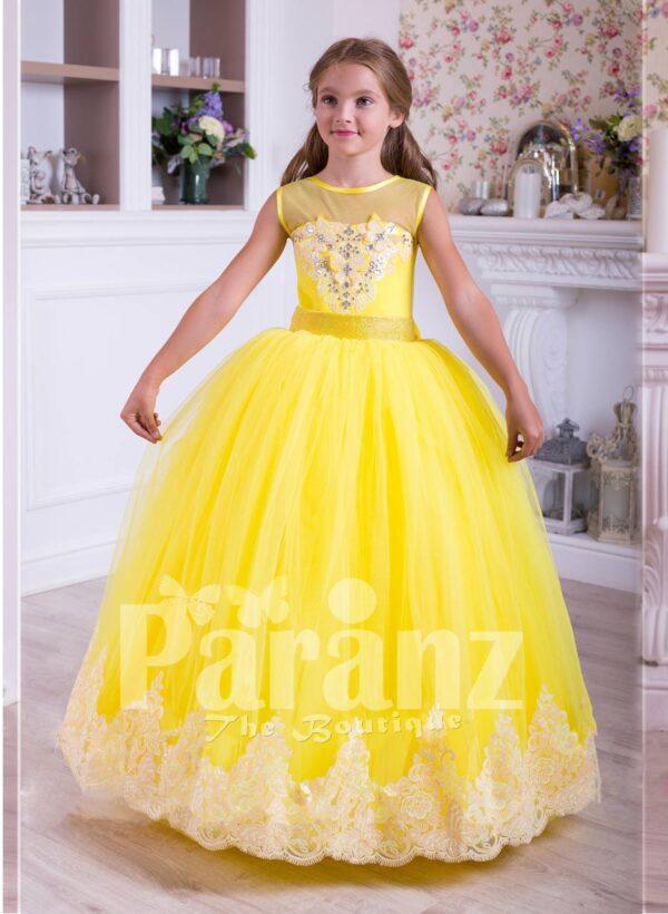 Bright yellow floor length tulle skirt dress with lace hem sleeveless satin-sheer bodice