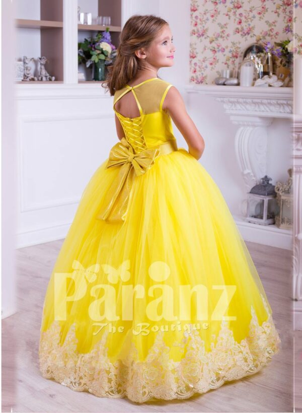 Bright yellow floor length tulle skirt dress with lace hem sleeveless satin-sheer bodice back side view