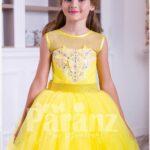 Bright yellow floor length tulle skirt dress with lace hem sleeveless satin-sheer bodice for girls