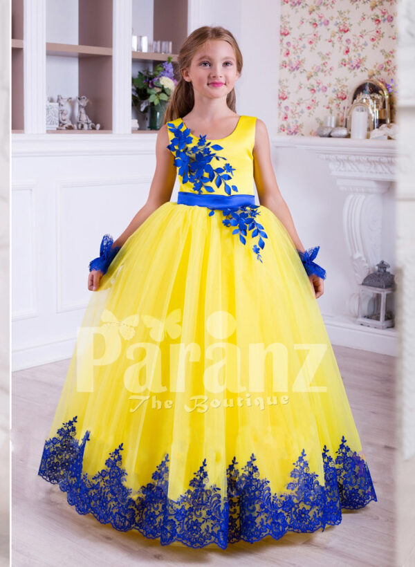 Bright yellow sleeveless floor length tulle skirt party gown with royal blue lace works