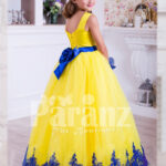 Bright yellow sleeveless floor length tulle skirt party gown with royal blue lace works back side view