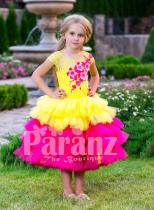 Contrast bright yellow-pink tea length baby party dress with ruffle skirt and floral bodice