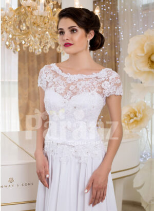 Elegant all white lacy bodice wedding gown with floor length tulle skirt Close view