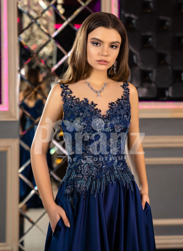 Elegant floor length pleated satin skirt evening party gown with royal sleeveless bodice close view