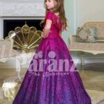 Elegant magenta pink floor length baby gown with all over blue glitz and royal bodice side view
