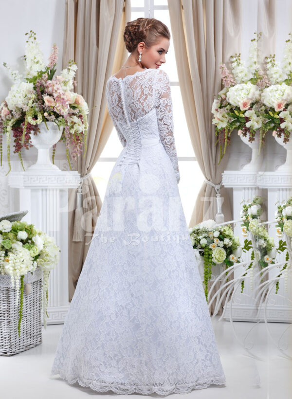 Elegant pearl white floor length tulle skirt wedding gown with over all lace works back side view