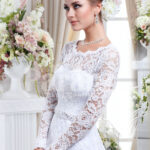 Elegant pearl white floor length tulle skirt wedding gown with over all lace works side view