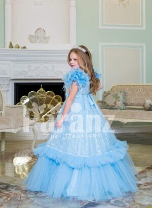 Elegant sky blue floor length baby gown with ruffle sleeve and long tulle-ruffle skirt side view