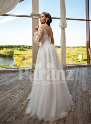 Elegant white soft tulle skirt wedding gown with full sleeve royal bodice back side view