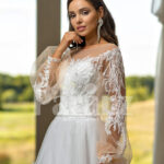 Elegant white soft tulle skirt wedding gown with full sleeve royal bodice close view