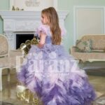 Exclusive high-low cloud tulle-ruffle skirt baby gown with beautiful bodice and feather sleeves back side view