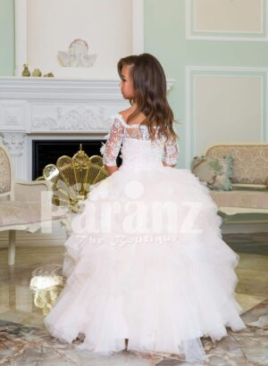 Exclusive pearl white high volume tulle-ruffle skirt baby gown with satin-sheer floral bodice back side view