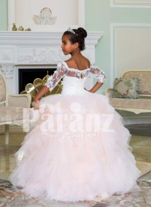 Floor length pearl white high volume tulle skirt baby gown with floral lace work bodice back side view