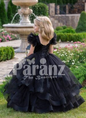Glam black floor length multi-layer tulle skirt gown with white floral work elite bodice back side view