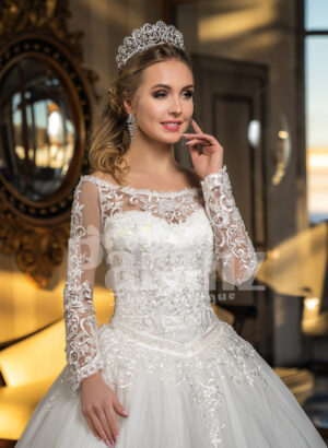 High volume tulle skirt wedding gown with full sleeve royal bodice in white close view